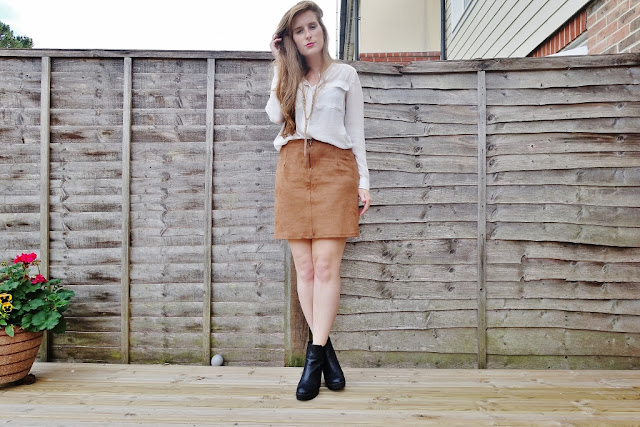 suede skirt and white blouse