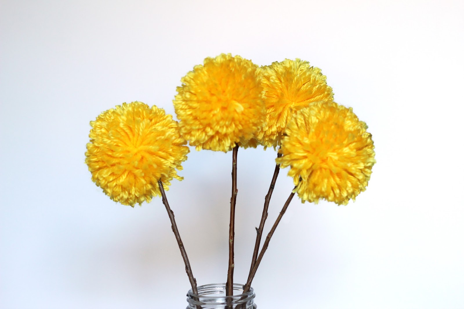 We can make anything pom pom flowers i like the look of the yellow flower because it sort of looks like a real flower i also think theyd look good in some oranges browns for autumn mightylinksfo