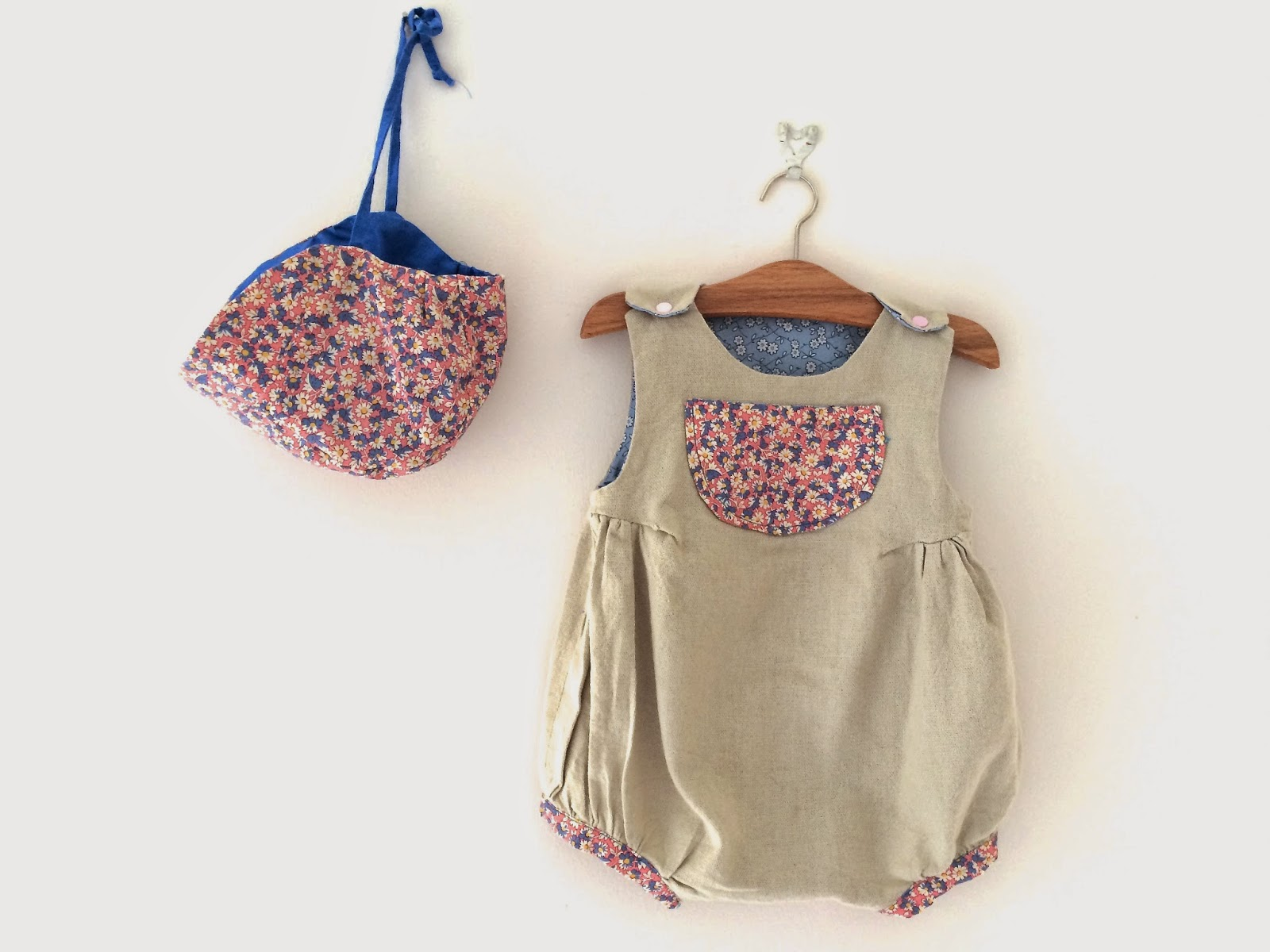 Super cute baby romper and matching bonnet.