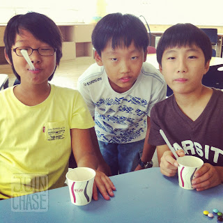 Elementary students playing games with Korean M&Ms during an English after school class in South Korea.