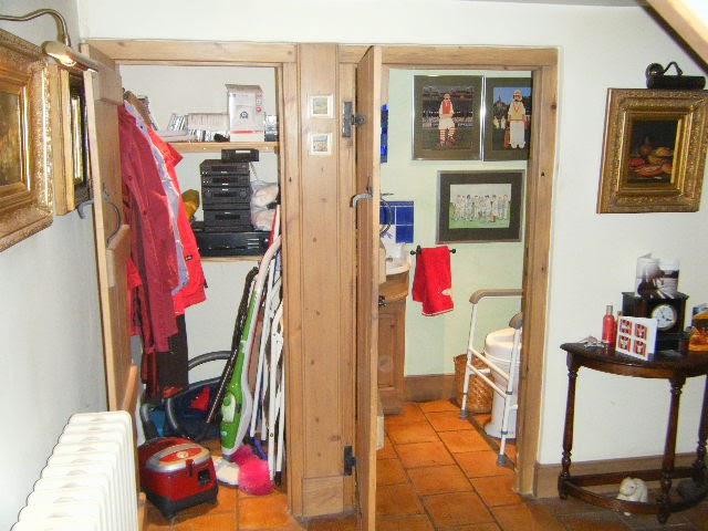 original arrangement of storage cupboard and wc