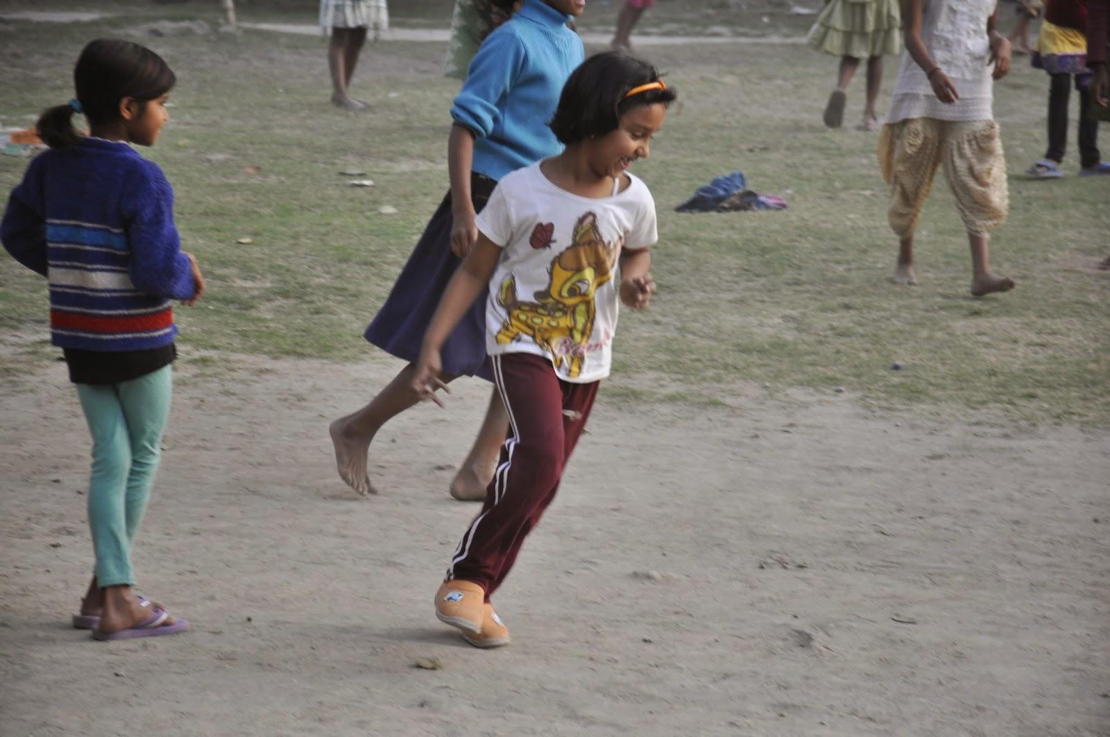 Children playing football at SPCI, a girls orphanage in Kolkata, India