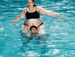 funny picture fat woman in swimming pool