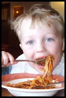 A child eating spaghetti