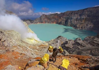 Crater of Ijen is filled by a spectacular turquoise blue lake