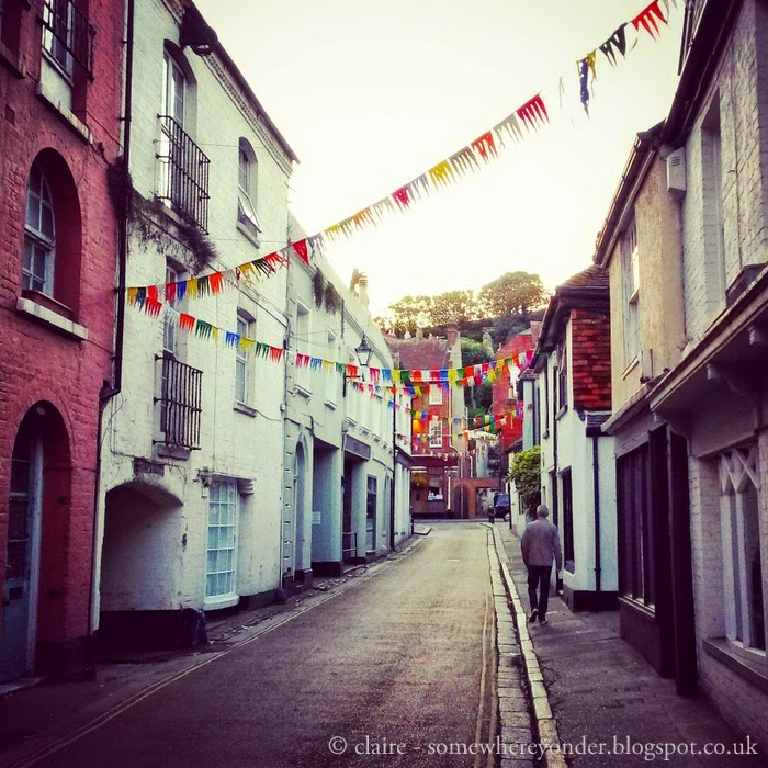 Walking along charming cobbled street with bunting in Hastings Old Town