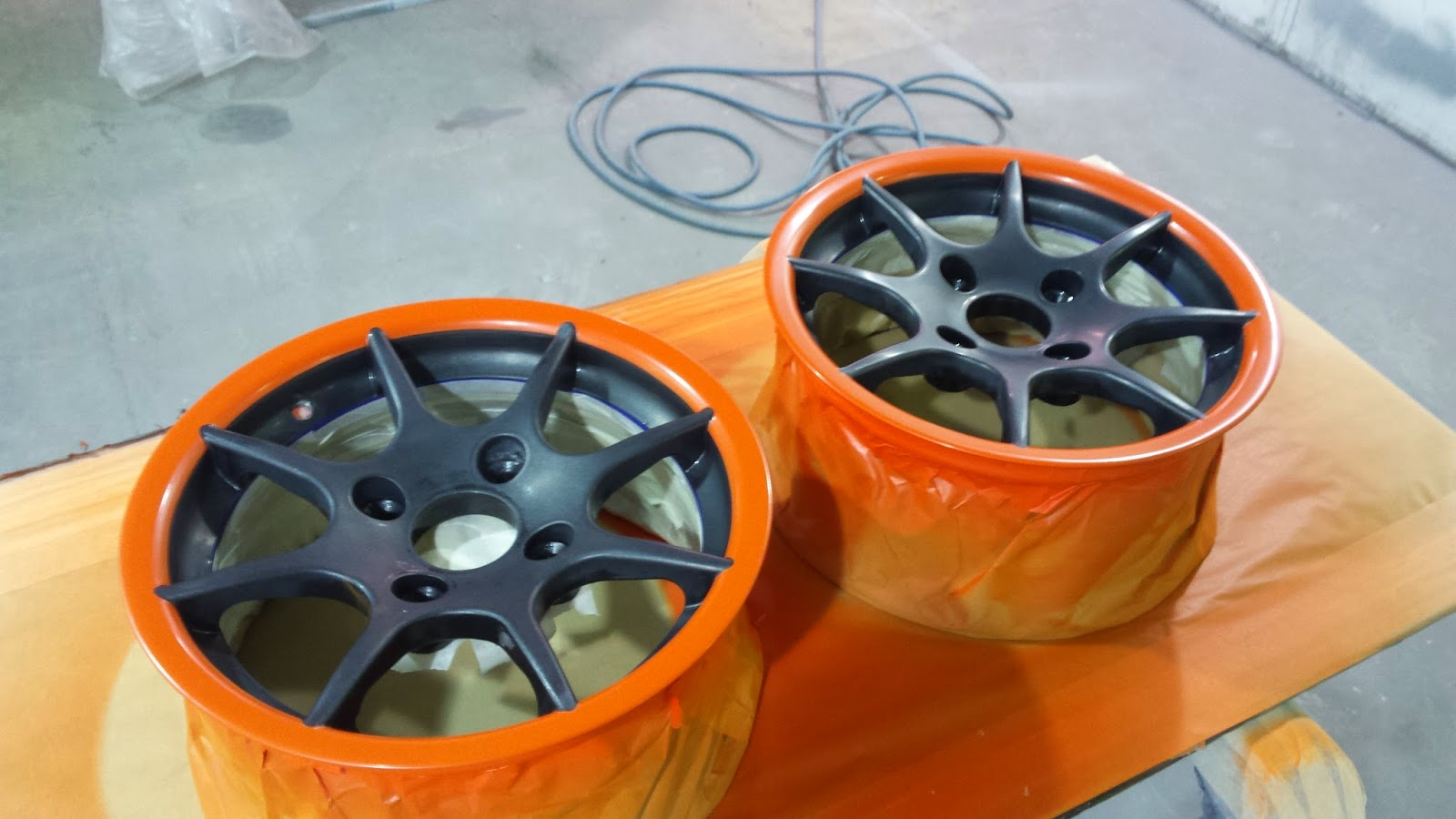 Two wheels painted with orange rims