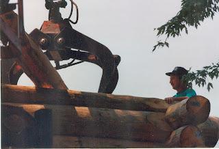 John Huisman, loader, logs ely mn whiteside park, bandshell