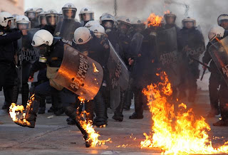Funniest pictures of police: Greek police on fire during a demonstration
