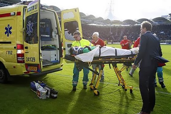PSV goalkeeper Przemysław Tytoń is seen being taken away on an ambulance stretcher