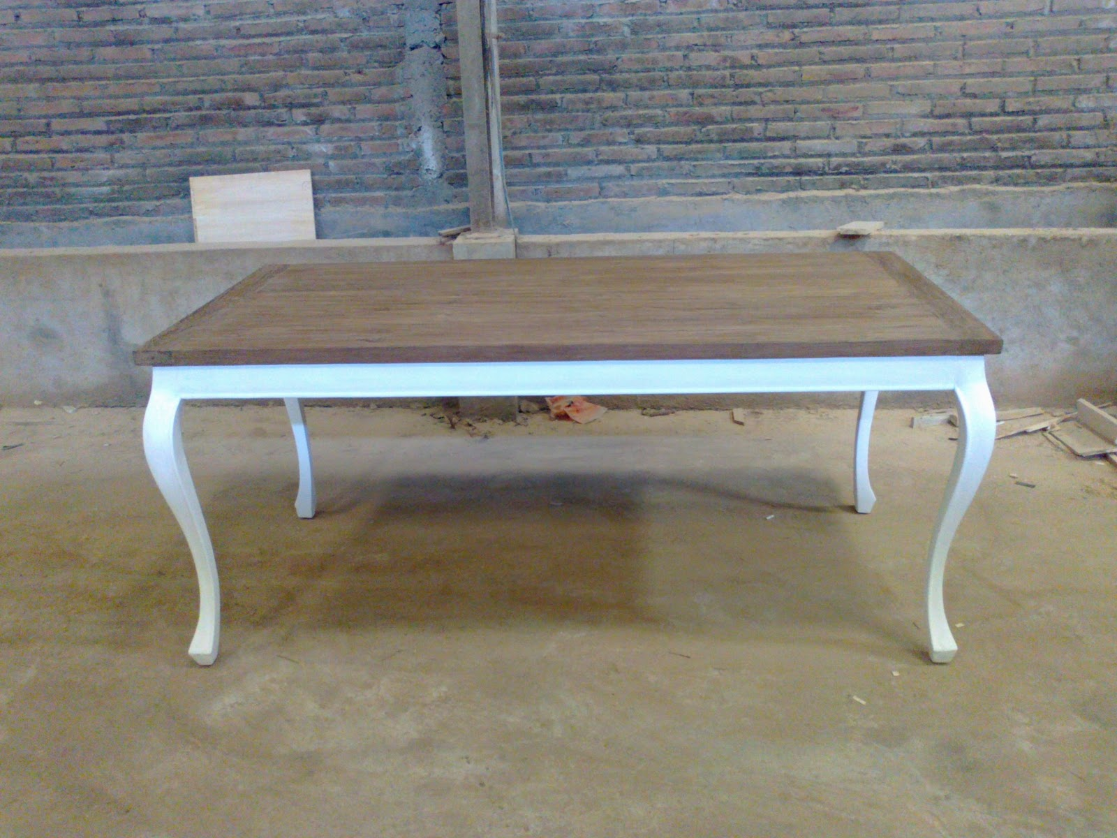 Dining table with legs made of mahogany wood handpainted white finishing and table top use rustic reclaimed teak is currently popular in europe