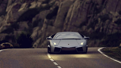 Black lamborghini on the road