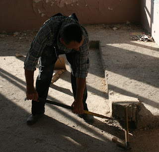 Bekir starts to lever up the platform