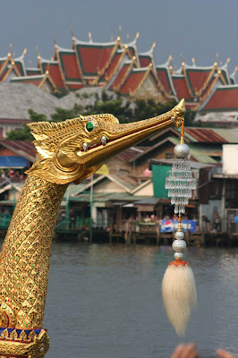 The Grand Palace makes a good background in Wat Arun, Khlong San, Bangkok, TH
