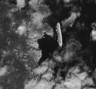 View of the stricken cruise ship which ran aground and capsized near the island of Giglio in Italy on 13 January. The image was taken on 17 January.