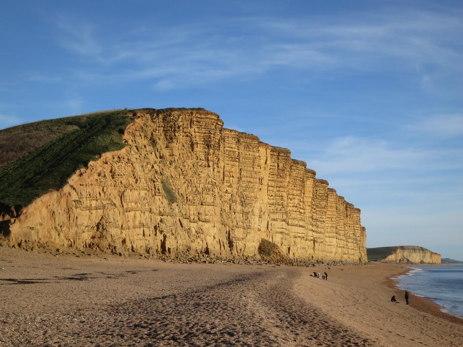 Golden cliffs of West Bay stretching towards Portland. Dorset.