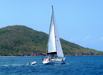 Dave and Heather aboard s/v Wild Hair as she sails the Caribbean Sea
