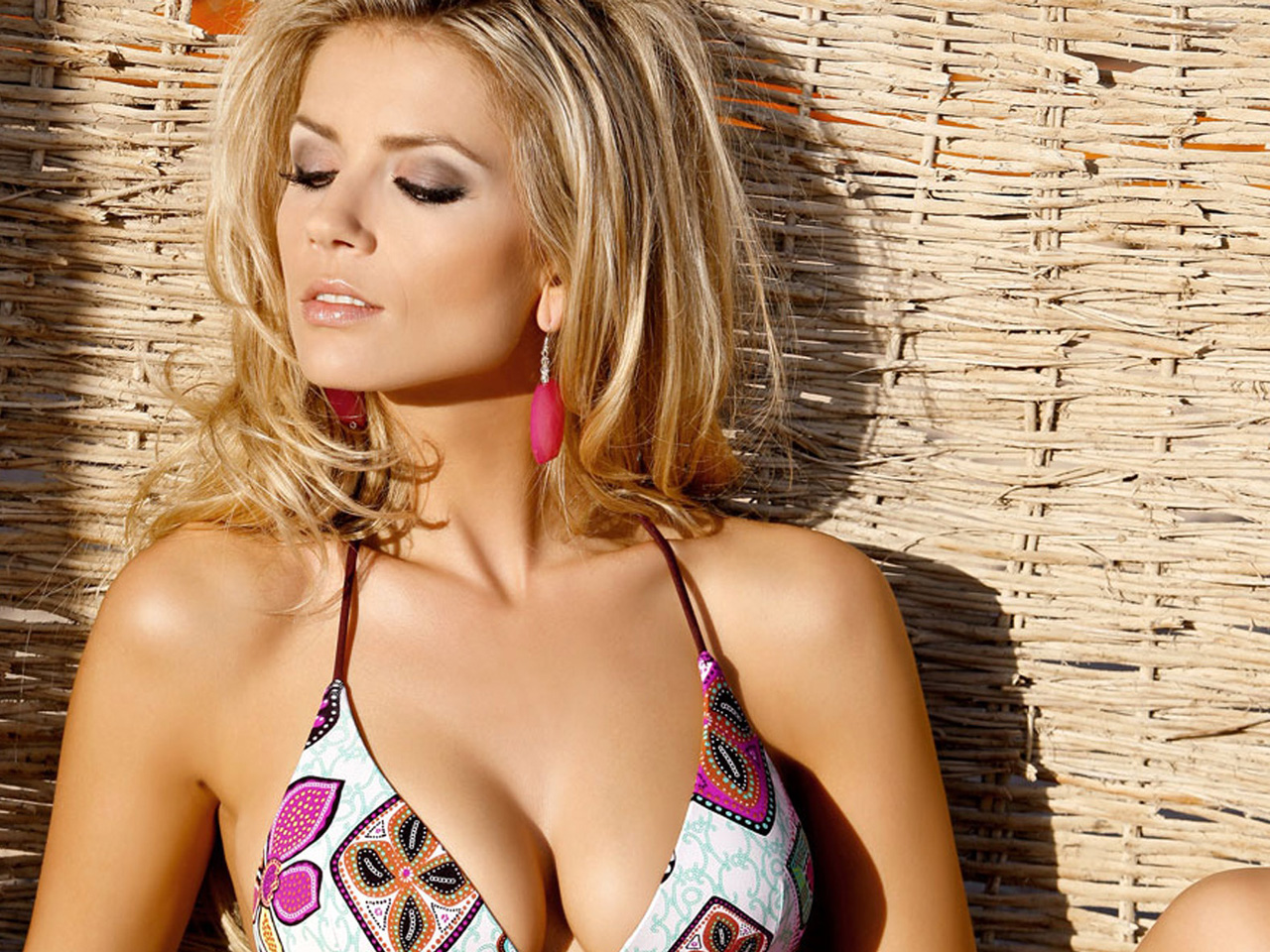 Bikini tops come in different styles and cuts, including a halter-style neck ...
