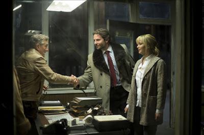Bradley Cooper, Robert De Niro and Jennifer Lawrence in Joy