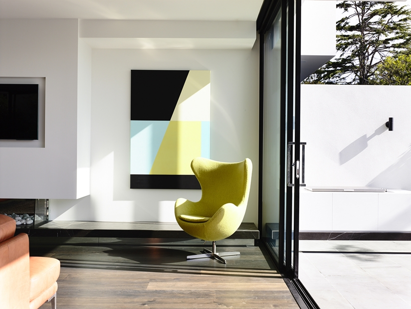 Yellow chair in Perfect Modern Townhouse by Martin Friedrich Architects