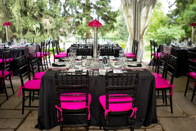 Black chiaviri chairs with black and white damask runner, pink chair seats.
