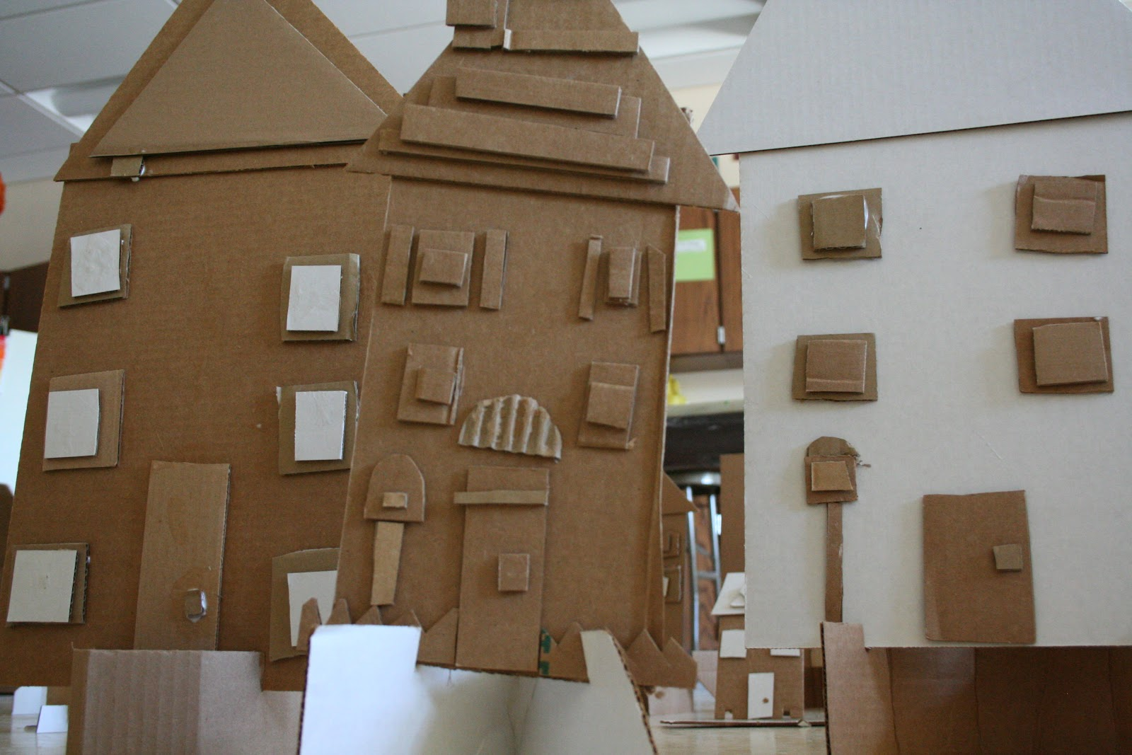 Art project girl recycled cardboard city for Cardboard for projects