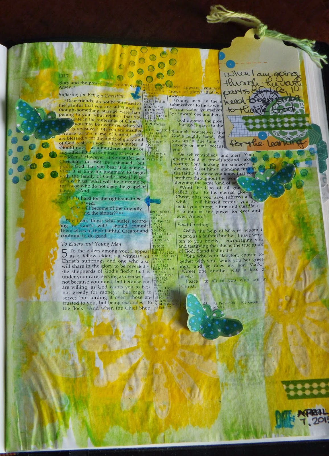 Art journaling Bible page inspired by 1 Peter 4: 12-13 with acrylic paint in green and yellow.
