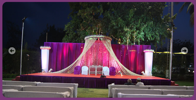A wedding planner indian wedding and reception stage for Indoor stage decoration