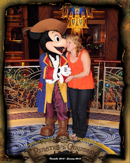 Mickey giving Gena a kiss