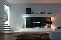 pared blanca decorada con dos muebles blancos rectangulares paralelos más una estructura rectangular negra porosa y con un fondo negro entre los muebles
