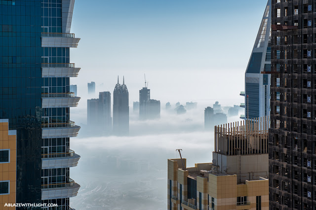Photo of Dubai buildings in the fog