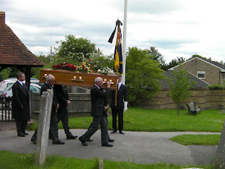 royal british legion flagbearer at funeral