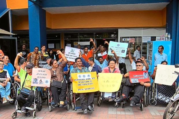 ILTC Malaysia members staged a protest outside JPJ Wangsamaju KL.