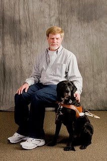 Kerwin Davis and black Lab Jag