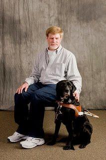 Kerwin Davis and black Lab Jag