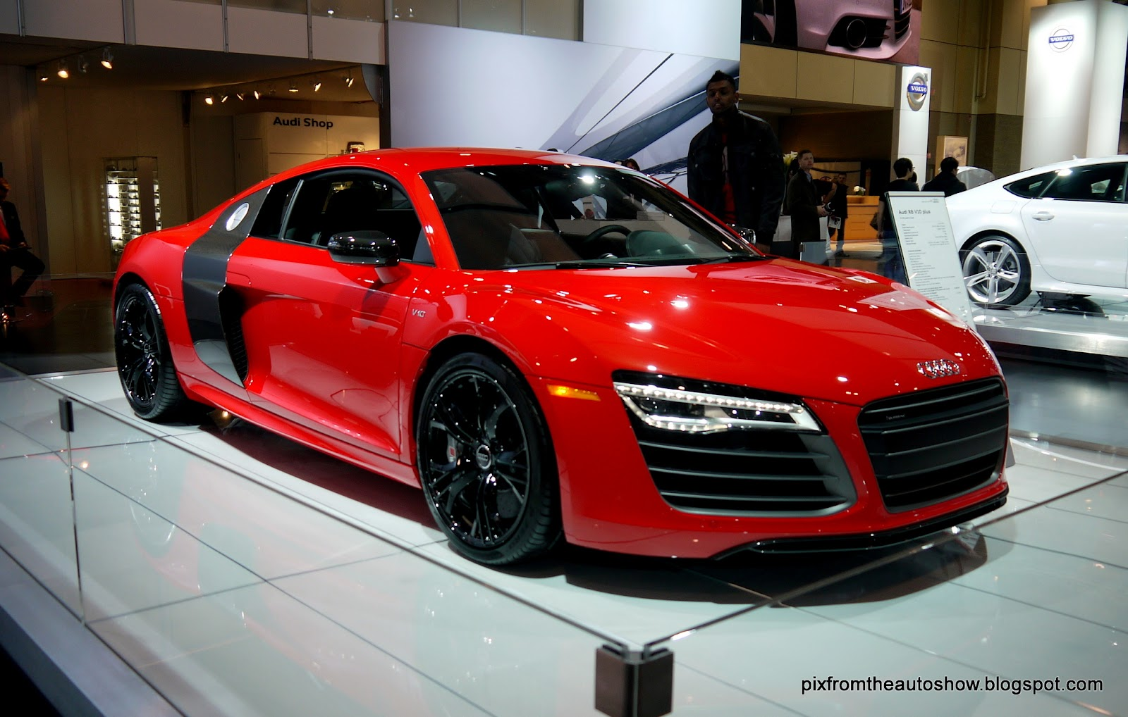 Here is the 2014 Audi R8 supercar with it's aggressive front and rear