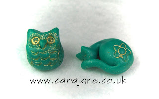 Cute owl and sleeping cat made from polymer clay