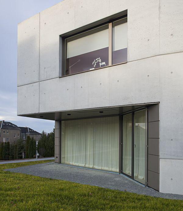 Casa minimalista con fachada en cemento todo sobre fachadas for Casa minimalista roja