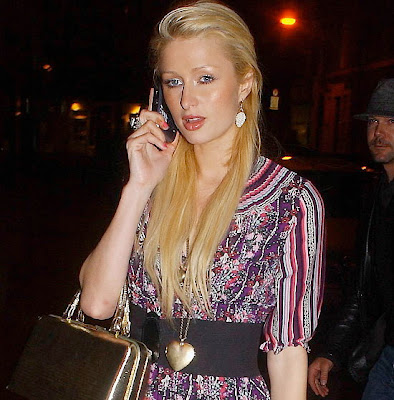 paris hilton with blackberry and handbag