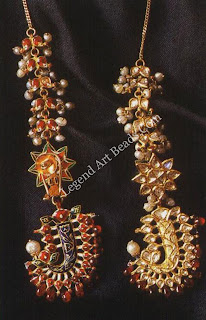 Kalgi pendant earrings, Jaipur  The pendants are shaped like the kalgi, the jewelled feather set in turbans. Kundan is fringed with spine's; there are Basra pearls including on the part that hooks the ornament to the hair. The reverse is enamelled.
