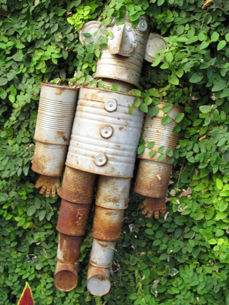 Tin can man trash to treasure project subtropical for Yard art ideas