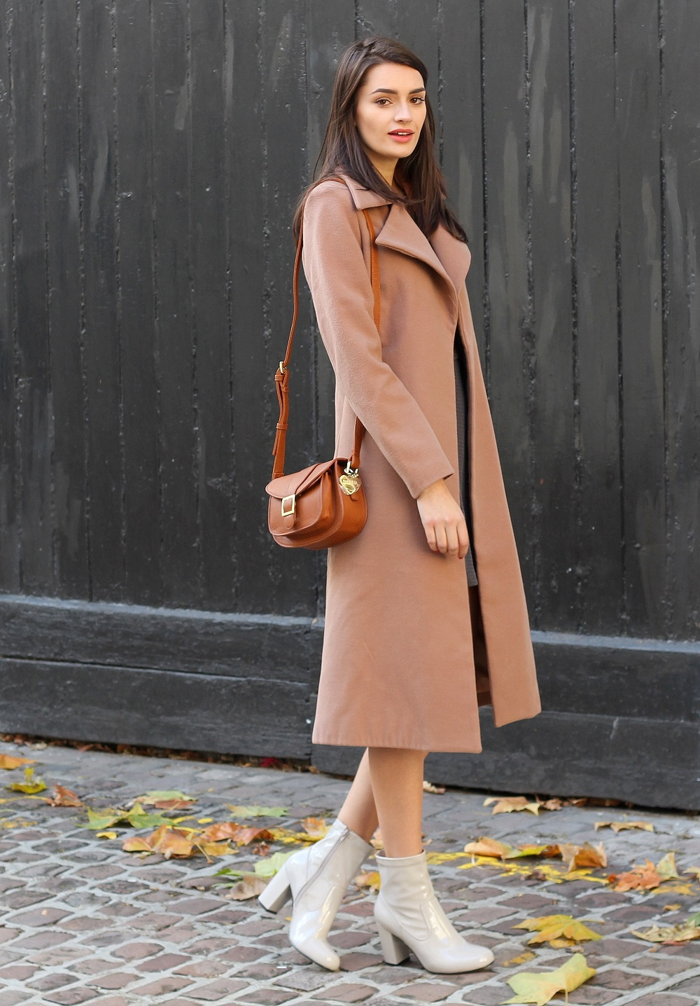 peexo fashion blogger wearing camel coat and patent grey boots