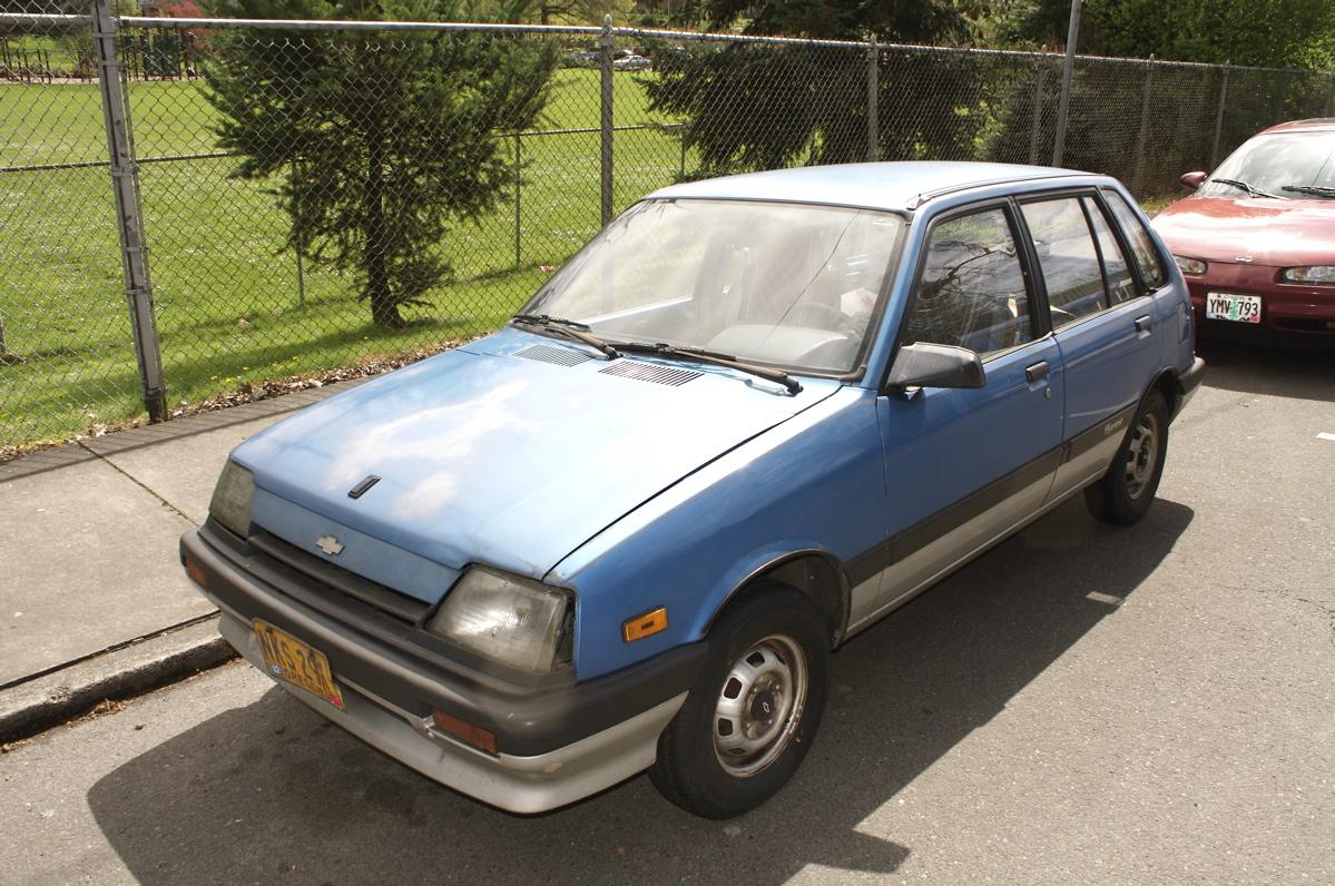 OLD PARKED CARS.: 1987 Chevrolet Sprint 5-Door Hatchback.