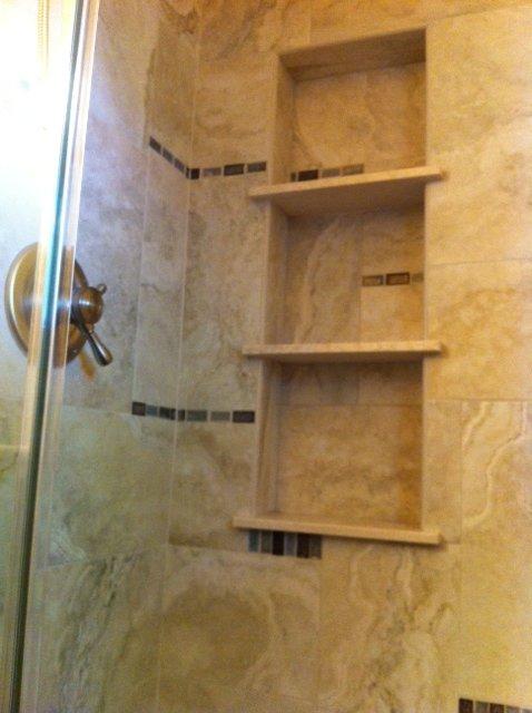 H winter showroom blog asymmetric tile design in the shower for Bathroom niche design