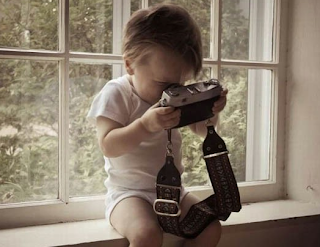 funny picture: child with camera
