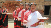 Newari ladies on single file procession visiting temples