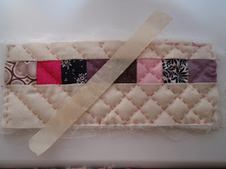 Quilting my mini thread catcher.
