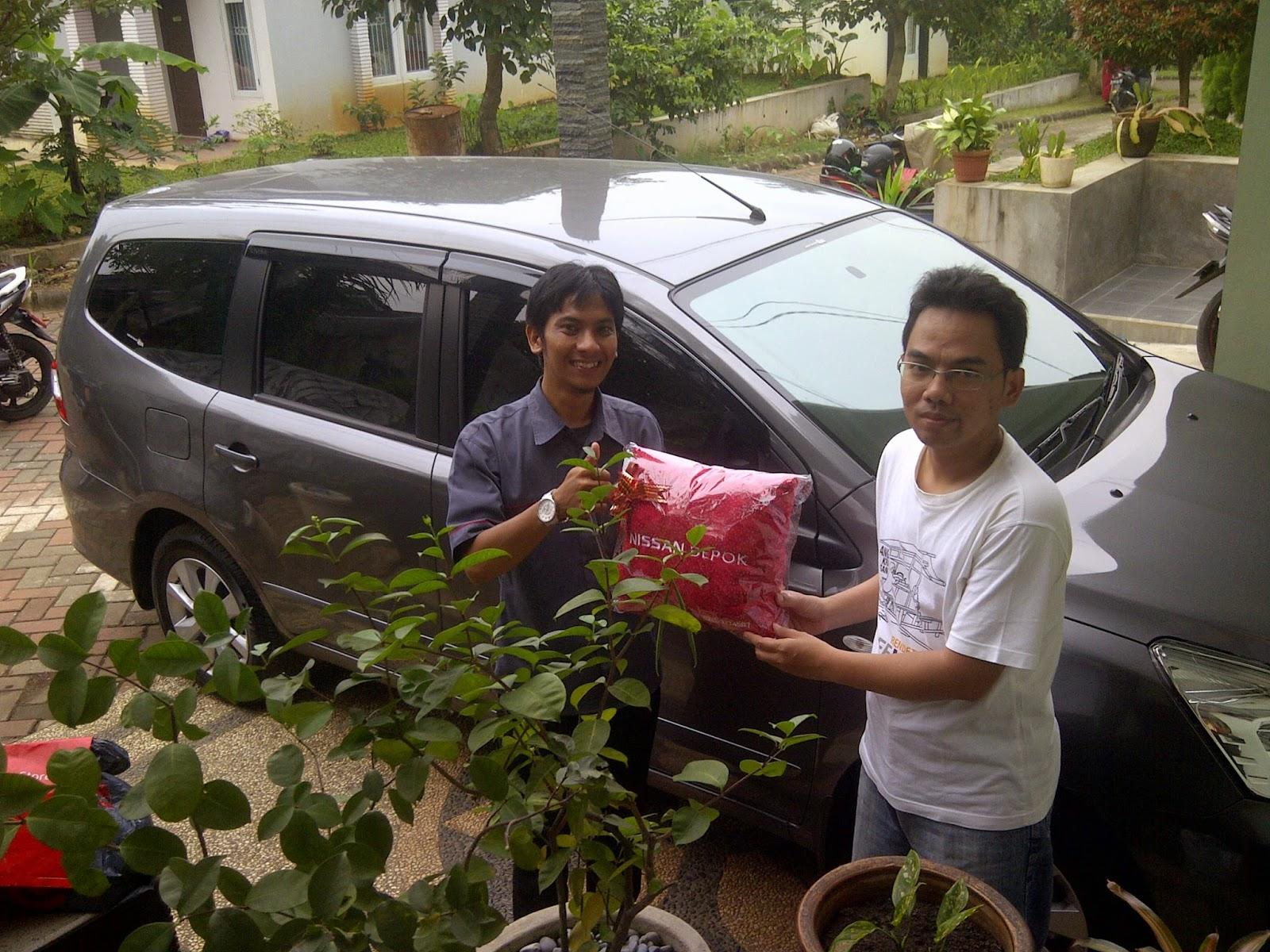 Terimakasih atas kepercayaan Pak Jakson dan Bu Reni yang telah membeli Grand Livina melalui media www.touchnissan.com.  Semoga Berkah ya Pak...