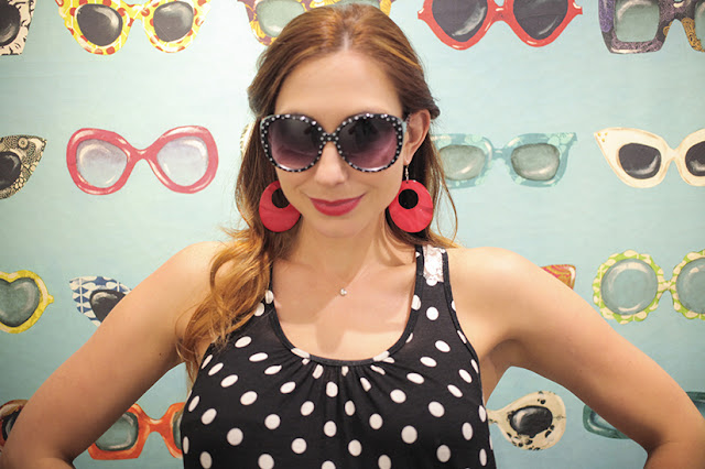 Travel and Fashion blogger Amy West in a playful polka dot outfit post.