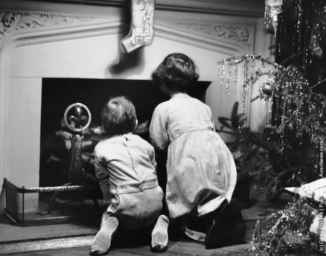 Two children waiting for santa claus photo by george marks retrofile getty